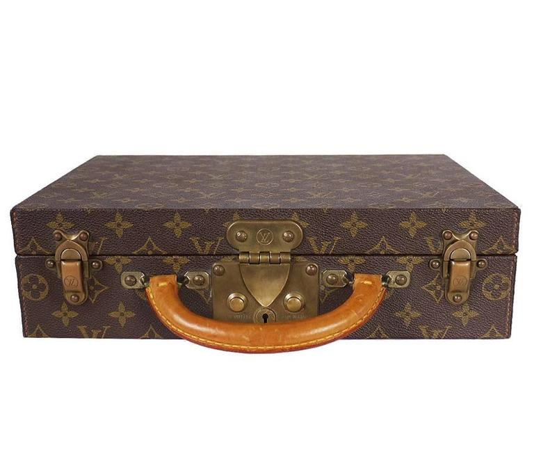 This is a beautiful used Louis Vuitton Jewelry case. This jewellery case in Monogram canvas is the ideal refined travel accessory. It features 13 different-sized compartments and closes securely with an S-lock and two trunk latches. Original Retail