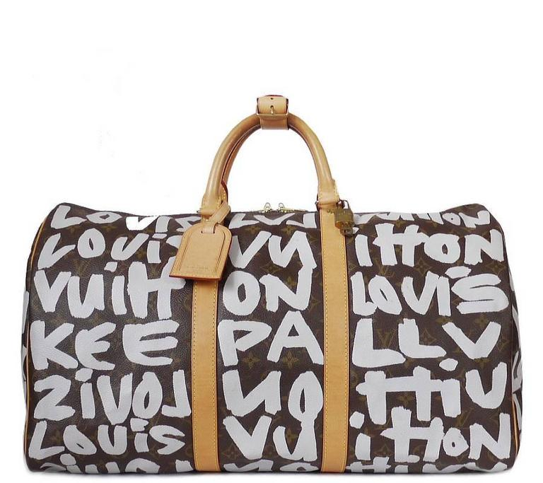 2a6de4fe764a Louis Vuitton monogram graffiti keepall 50 designed by Stephen Sprouse.  Collectible item