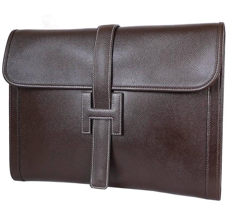 Hermes Jige GM clutch bag. This over-sized clutch bag is for unisex use. Large enough to use as clutch, document case or tablet case. One owner, worn just few times. Truly beautiful bag.      Main color and Material : Brown, Couchevel     Blind