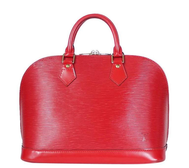 Louis Vuitton Epi Alma handbag in Red. Vintage LV alma handbag with brass hardware. Never out of style, Classic LV handbag.