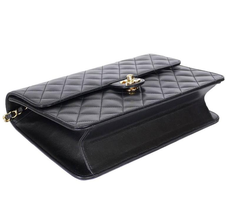 088796297e0b Flap closes securely with golden turn lock. Chanel Black Lamb Skin 2.55 3way  Classic Flap Bag In Excellent Condition For Sale In Hiroshima