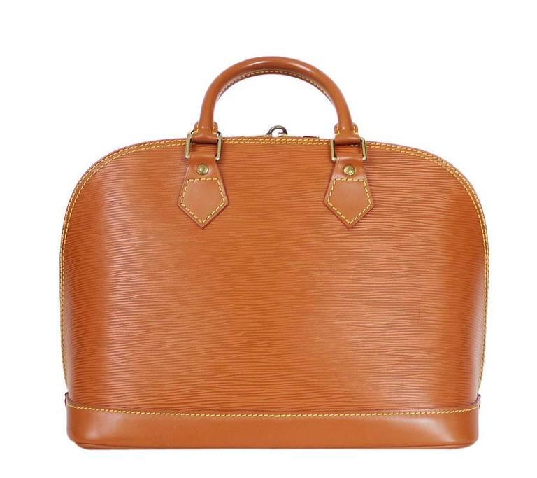 Louis Vuitton Epi Alma handbag in Zipangu Gold. Vintage LV alma handbag with brass hardware. Never out of style, Classic LV handbag.      Color : Zipangu Gold     Material : Epi leather     Date Code: MI0996     Lining : Micro fiber     Comes