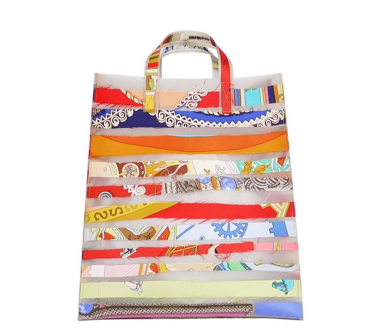 Extremely rare, Hermes Silk scarf strips tote bag. This is the Louvre Museum limited edition from 2004-2005.These unusual, colorful bags designed by Luisa Cevese for Hermes boldly mix two seemingly contradictory materials; Silk and Polyurethane. The