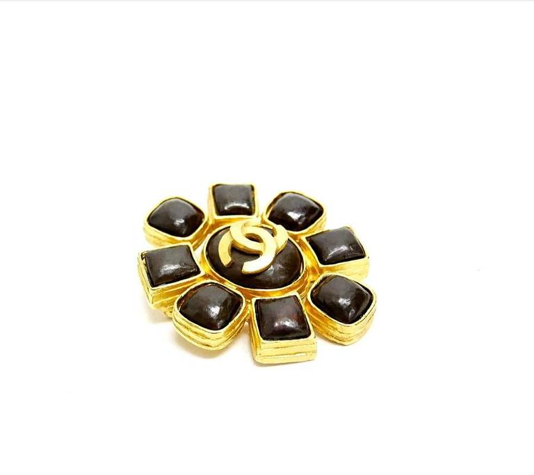 Vintage Chanel Stone earrings and Brooch set. Black(Deep brown) stones are placed on each earrings and brooch. Brooch is large size and quite gorgeous. Both are well cared, very beautiful condition. Collectible vintage Chanel Jewelry. A perfect