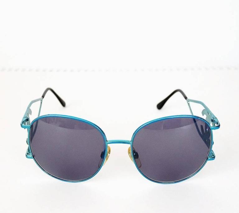 "Rare Chanel CCLovo sunglasses. This is quite hard to fund, collectible vintage Chanel from early 1990s.  Material: blue metallic metal Cons with: non Chanel sunglasses case Frane: 14.5cn(5.31 inches) Lens: 5cmx6cn(2.36""cm x 1.96"")  Condition:"