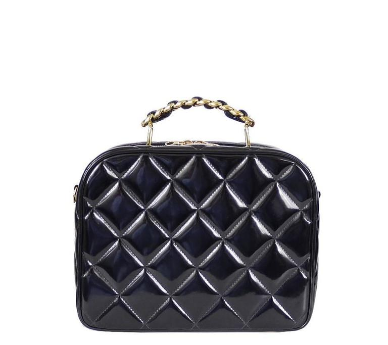 Chanel Black lunch box is the super rare model from 1990's. Shoulder strap is detachable and you can wear the bag as handbag or cross-body bag. Nicole Richie is wearing same bag. Because this bag is made from patent looking plastic, surface never