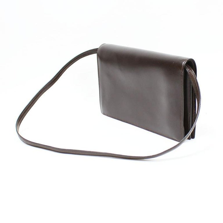 Hermes Annie 2way shoulder bag. This is a rare vintage Hermes bag wearable as clutch or shoulder bag.  A symbol of Hermes, H logo is placed in front of the bag.       Main color : Brown     Material : Box Calf     Comes with : Detachable shoulder