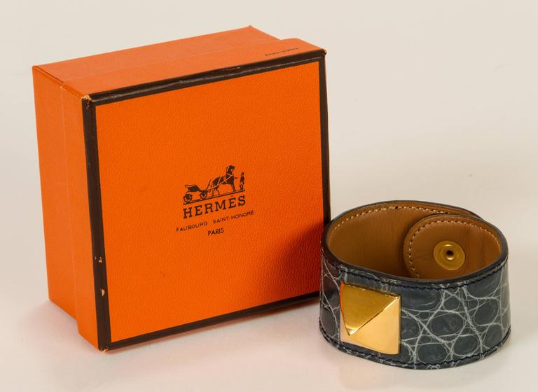 Hermès Medor bracelet with snap clasp, 1993. Made with crocodile leather, in excellent condition. Size W. Comes with original box.