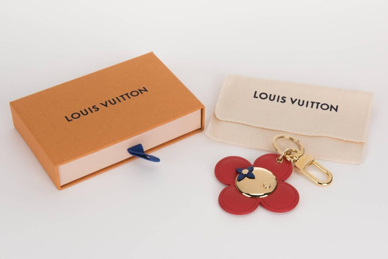 Louis Vuitton sold out vivienne flower  keychain, bag charm . Red and pink reversible leather . Comes with original dust cover and box.