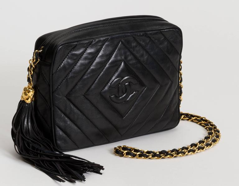 Chanel black lambskin chevron camera bag with dangling tassel. Shoulder  drop 21 7d36cf246cd9