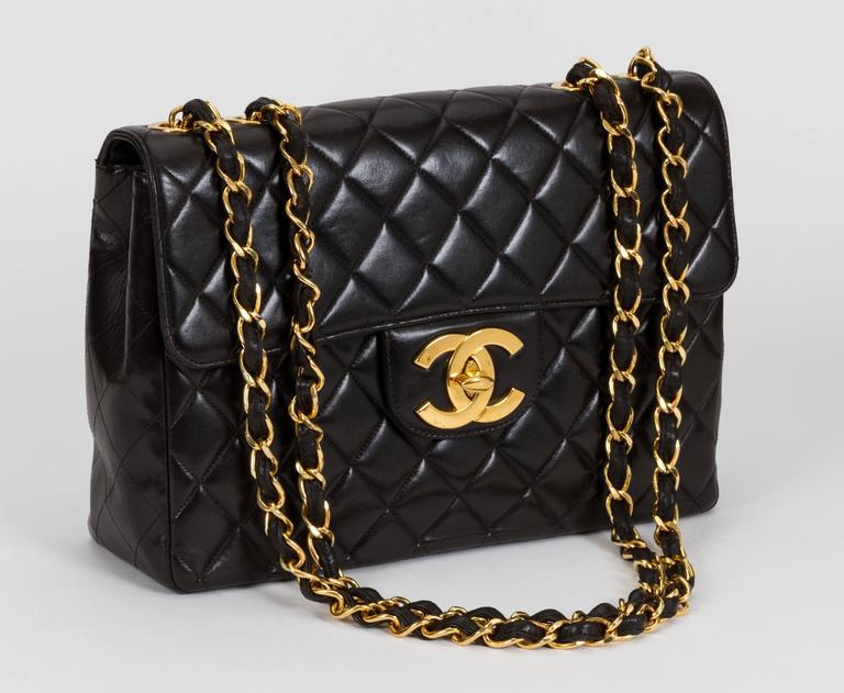 "Vintage Chanel black quilted lambskin jumbo single-flap bag. Signature oversize CC logo turn-lock clap. Black leather interior. Very good condition. Can be worn with strap long, 25""L, or doubled, 14""L. Collection 1996/1997. Comes with hologram and"