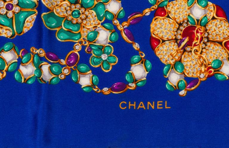 Chanel electric blue silk twill scarf with multi colored jeweled stones. Hand rolled edges. Does not include box.