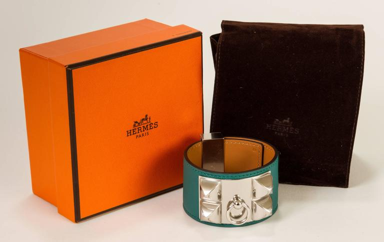 "New Hermès, never-worn Collier de Chien bracelet with malachite and palladium hardware. Stamped ""Q"" for 2013. Comes with original dust bag and box."
