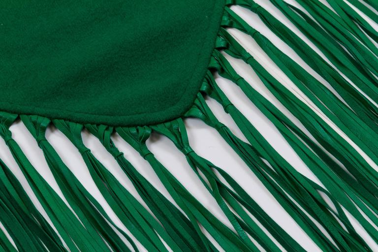 Hermès emerald green 100% cashmere shawl with lambskin fringe. Comes with original box.