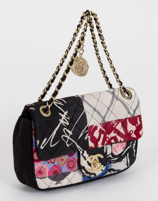 """Chanel single-flap cross-body bag in black jersey and multicolored patchwork fabric with coin charm. Drop, 12""""L/22""""L. Comes with hologram, card, and dust cover. Minor wear."""