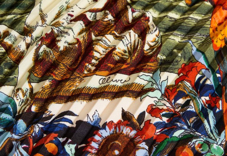 Hermès Colombus pleated scarf designed by Kermit Oliver. Comes with original box and ribbon.