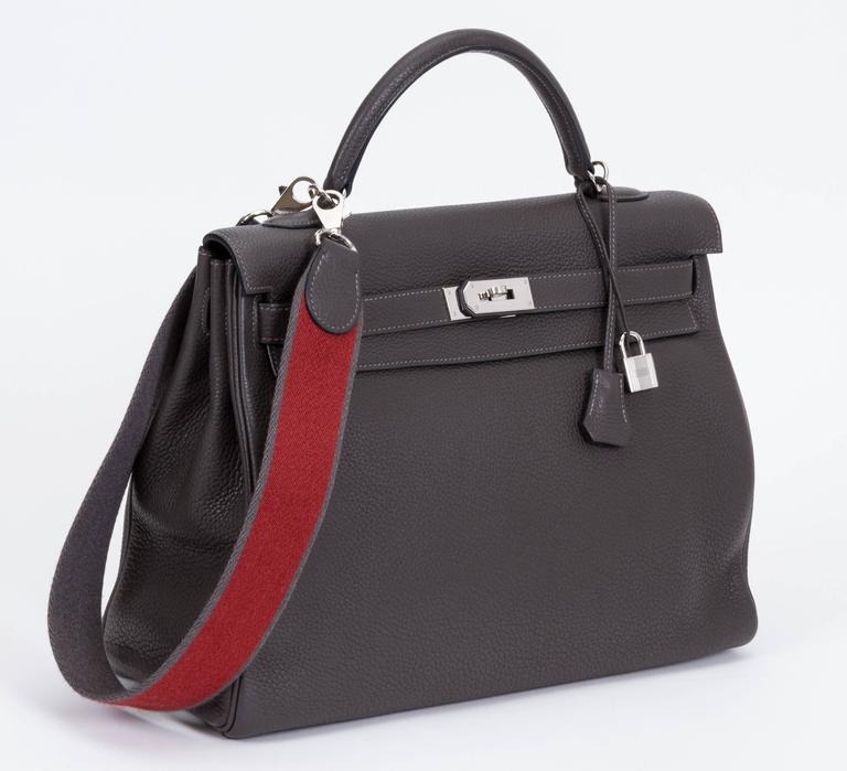 314ba2228f5 Hermès Kelly bag in graphite clemence leather and palladium hardware. 40cm.  Detachable strap in