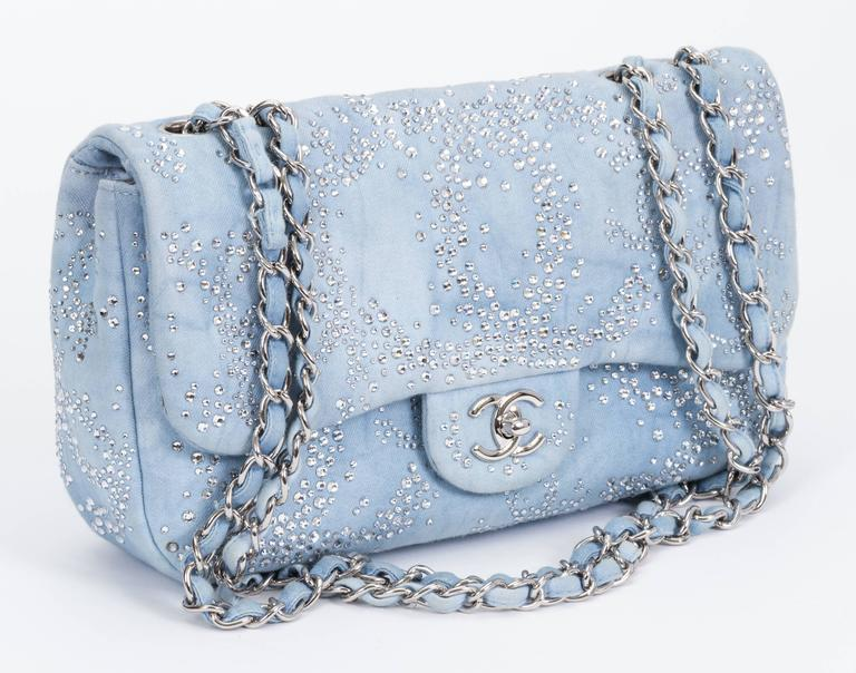 "Chanel collectible denim and rhinestone flap bag. Shoulder drop, 13"" - 25""L. Can be worn cross body. Collection 2010/2011. Comes with hologram, id card, booklet and original box."