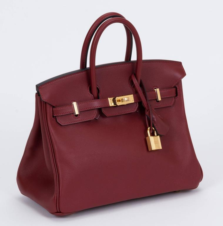 f124a4b8b Hermès never used Birkin bag 25cm. Swift rouge H leather with gold tone  hardware.