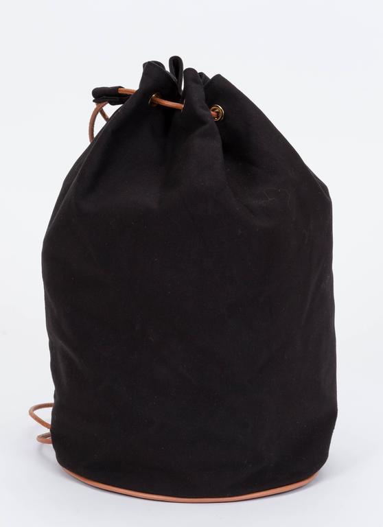 """Hermes black toile backpack with cuir leather details . Shoulder drop 11""""."""