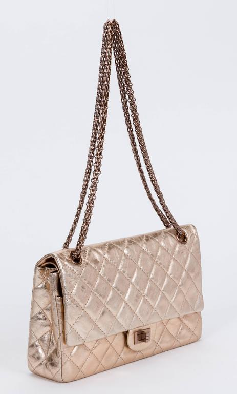 "Chanel authentic rare maxi double flap, reissue collection. Gold metallic distressed leather and thick gold mademoiselle chain. Collection 2008/2009. Original store price $6,600. Shoulder drop 11""/18"". Comes with hologram and original box."