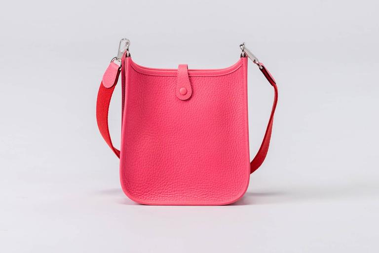 Hermès mini Evelyne shoulder bag in rose azalee clemence leather with palladium hardware. Two tone rose azalee strap/rouge pivoine. Never used. Dated
