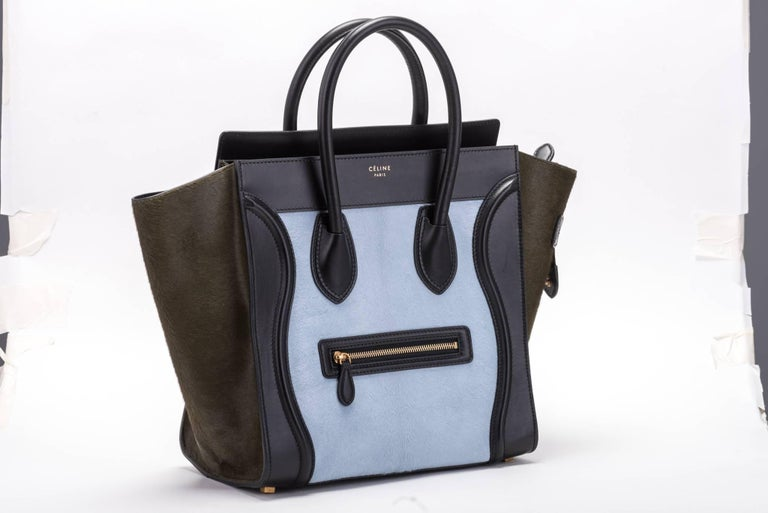 Celine tricolor mini luggage in black calfskin leather and pony hair.  Hand carry with 5