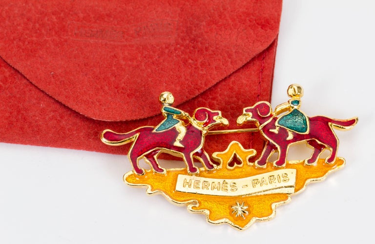Hermes enamel multicolor enamel Christmas pin with gold tone plating. Comes with red suede pouch.