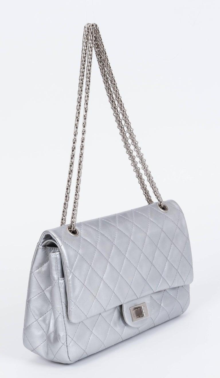 Chanel jumbo reissue silver double flap. Metallic silver leather and silver metal. Can be worn cross body. Shoulder drop 11