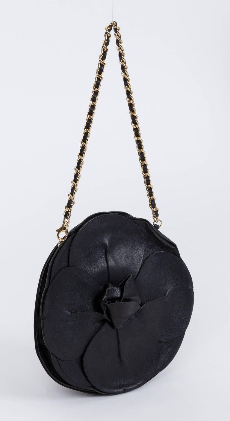 Chanel evening bag shaped as a camellia flower, black leather and black silk combination. Can be worn with or without the strap. Shoulder drop 7.5