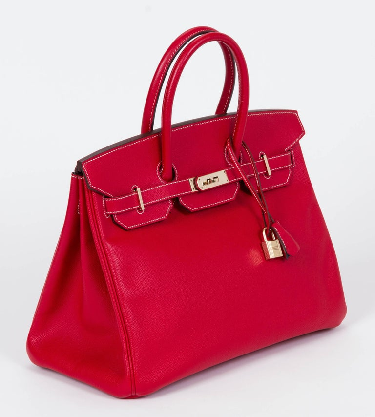 Hermes rare and collectible candy color collection Birkin bag 35 cm in rouge casaque epsom leather/talahasa blue goatskin and goldtone hardware. Date stamp P for 2012. Handle drop 4.25