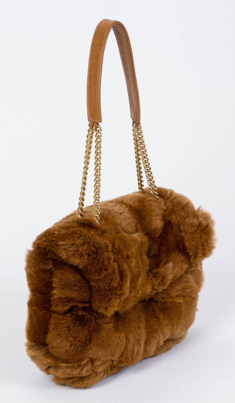 "Camel chinchilla flap bag by Chanel from 2005. It features a camel leather interior and gold hardware. Minor use and wear in the interior leather of the bag. Handle drop 8"" Dust bag included."