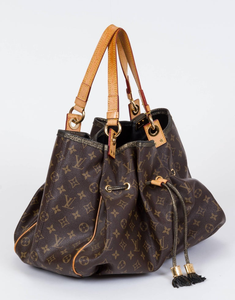 Louis Vuitton Preowned Shoulder Tote In Monogram Canvas Natural Cowhide Straps And Gold Tone Tassel