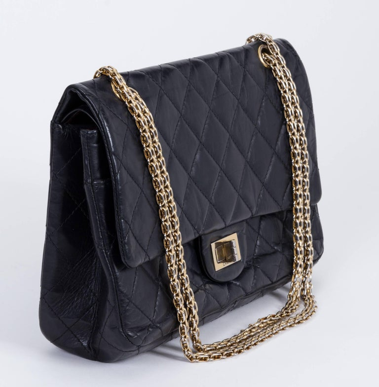 Chanel jumbo reissue double-flap bag. Black distressed leather and gold tone hardware metal. Can be worn cross body. Shoulder drop: 11