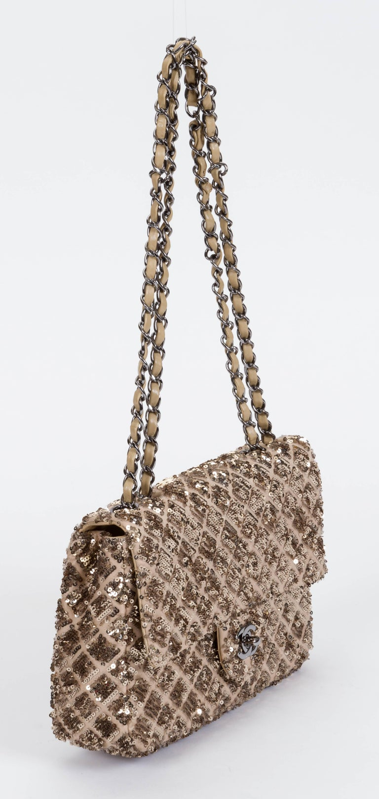 Chanel beige and gold sequins medium flap in excellent exterior condition. Interior stains, please refer to photos. Collection 2012/2013. Shoulder drop 11.5