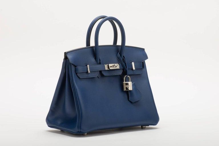 671e1195d9f1 Hermès 25cm Birkin in blue nuit swift leather with palladium hardware.  Handle drop