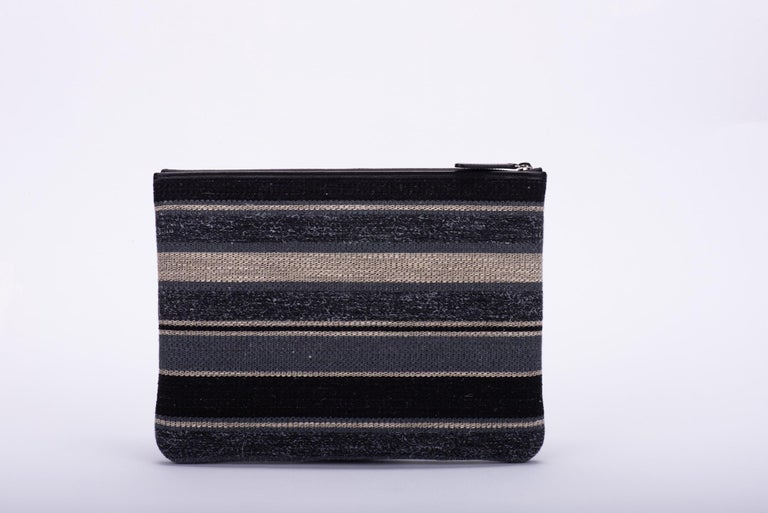New in Box, Chanel Medium Black Striped Clutch Bag In New Condition For Sale In West Hollywood, CA
