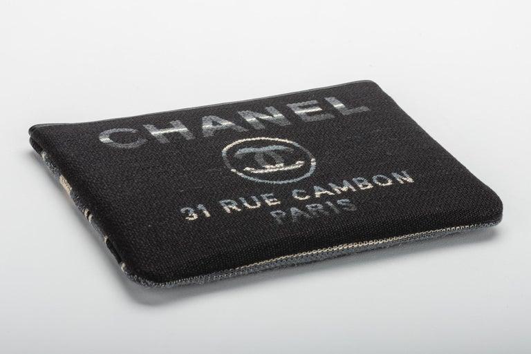 Women's New in Box, Chanel Medium Black Striped Clutch Bag For Sale
