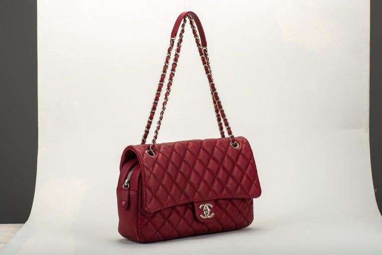 Chanel cherry red caviar jumbo flap with zipped closure. Shoulder drop 10.5