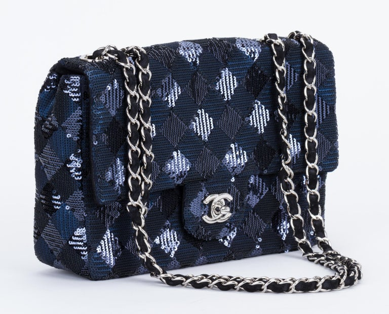 Chanel black and blue sequins quilted design evening single flap with silver tone hardware.Can be worn cross body. Shoulder drop 12