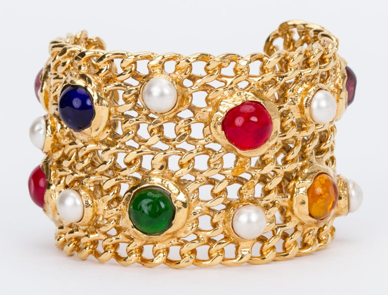 Chanel collectible faux pearl and multicolor gripoix (poured glass) chain cuff bracelet. Interior length 5.5