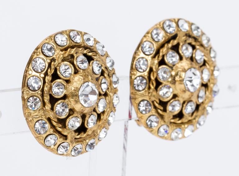 Chanel round gold and rhinestone 70s clip earrings. Come with original box.