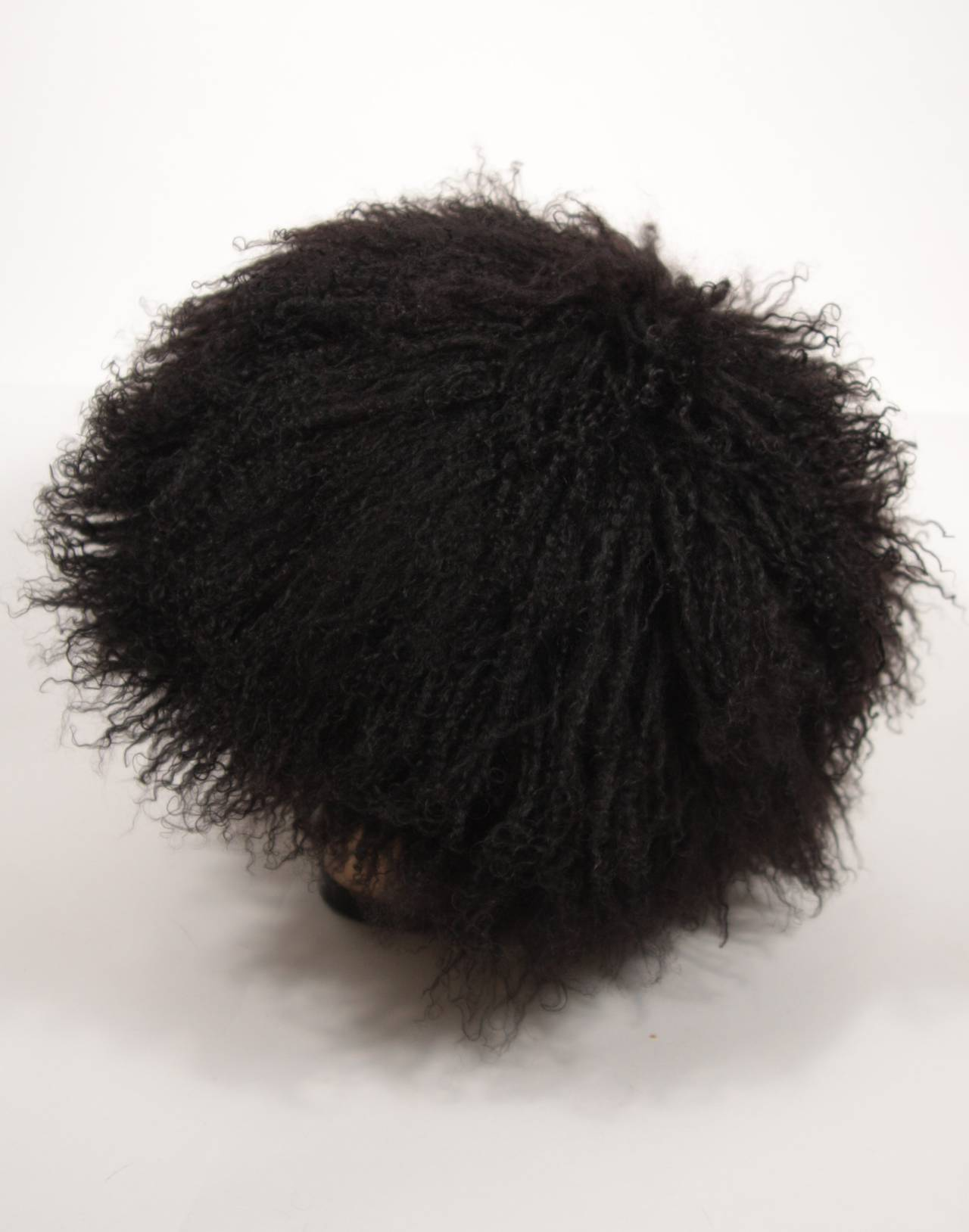 This Patricia Underwood hat is composed of an ultra supple Mongolian lamb. 