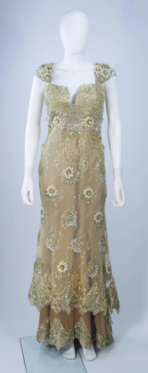 This Barraci gown is composed of a gold and yellow lace/silk combination which is embellished with rhinestones. There is a boned foundation, center back zipper closure, and corset style lace up back. In excellent vintage condition.   **Please