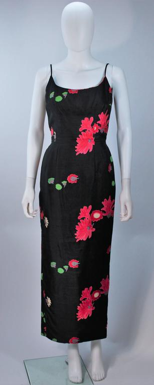 This dress is composed of a floral printed silk. There is a center back zipper closure and bow detail, with pleated hem. In excellent vintage condition.     **Please cross-reference measurements for personal accuracy. Size in description box is