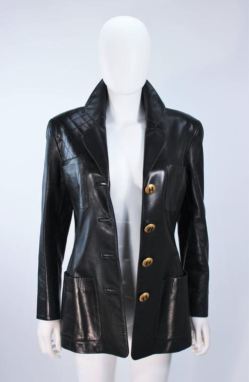 Women's CHANEL Black Leather Jacket with Quilted Accent and Gold Buttons Size 8 For Sale