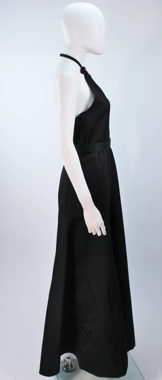 black satin halter gown with jeweled rhinestone