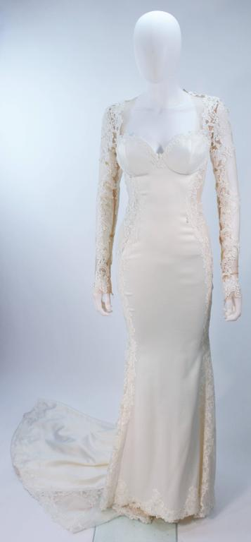 This Galia Lahav  gown is composed of a thick cream jersey with floral applique and sheer details. Features structured cups, and a side zip closure with snaps. An absolutely stunning design. In excellent vintage condition.     **Please