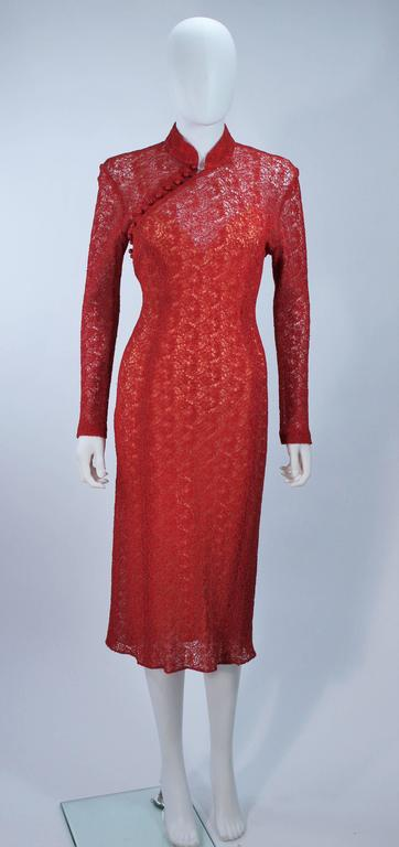 This Monique Lhuillier cocktail dress is composed of a stretch sheer lace material and stretch bias cut silk slip. There is a side zipper closure with buttons at the neck. In excellent vintage condition.     **Please cross-reference measurements