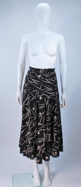 This Krizia skirt is composed of a black silk with an electrified print. Features a wrap style with button closure and panel detail. In great vintage condition.     **Please cross-reference measurements for personal accuracy. Size in description
